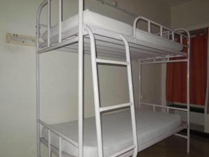A bunk bed or bunk beds in a room at The Lost Hostel, Madurai