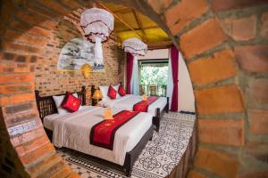 A bed or beds in a room at Hue Ecolodge