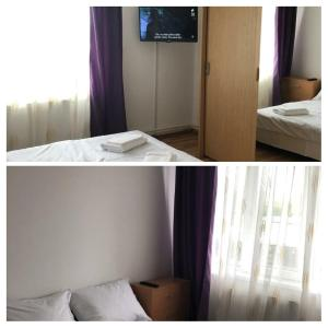 A bed or beds in a room at Sclipici Apartament
