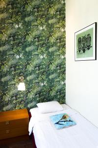 Säng eller sängar i ett rum på Hotel Finn