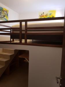 A bunk bed or bunk beds in a room at Riad El Maâti