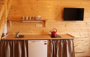 Kuchyň nebo kuchyňský kout v ubytování Sport-hotel Šibeniční vrch