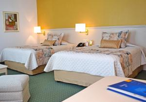 A bed or beds in a room at Hotel Europa