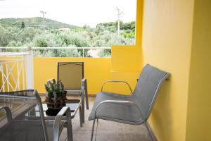 A balcony or terrace at Sunset Apartments Free shuttle from Athens Airport