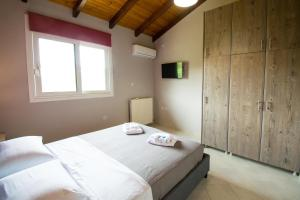 A bed or beds in a room at Sunset Apartments Free shuttle from Athens Airport