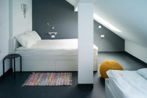 Кровать или кровати в номере Good People Design Hostel