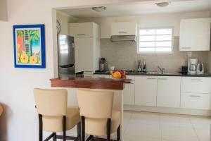 A cozinha ou cozinha compacta de Jan Thiel Garden Apartement