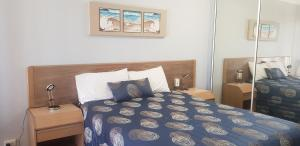 A bed or beds in a room at Rainbow Sands Resort