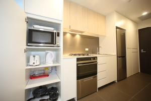 A kitchen or kitchenette at Arena On The Beach
