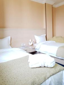 A bed or beds in a room at King Hotel Astana