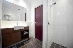 A bathroom at Grosvenor Hotel Adelaide