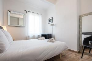 A bed or beds in a room at Le Major- Bel appartement dans le centre