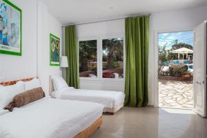 Ein Bett oder Betten in einem Zimmer der Unterkunft Arlene Boutique