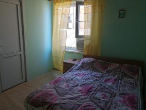 Кровать или кровати в номере Гостевой дом на Западной