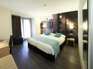 A bed or beds in a room at ELE Enara Boutique Hotel