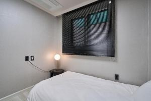 A bed or beds in a room at Designers Flat