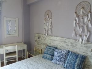 Ένα ή περισσότερα κρεβάτια σε δωμάτιο στο Amazon Studios