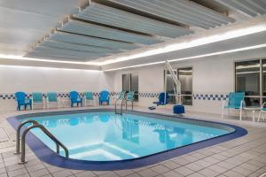 The swimming pool at or near AmericInn by Wyndham Duluth