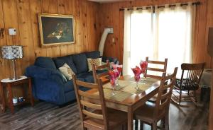 A seating area at Knotty Pine Cottages