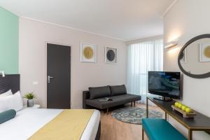A television and/or entertainment center at Leonardo Club Hotel Dead Sea - All Inclusive