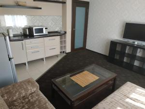 Телевизор и/или развлекательный центр в Vizavi Apartments