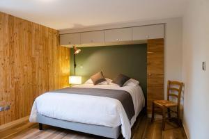 Un ou plusieurs lits dans un hébergement de l'établissement Le Jas du Mas