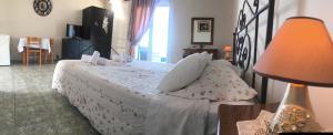 Ένα ή περισσότερα κρεβάτια σε δωμάτιο στο Maria Anastasia Studios