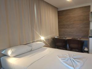 Cama ou camas em um quarto em MARULHOS RESORT - STÚDIOS TEMPORADA