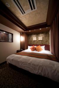Ein Bett oder Betten in einem Zimmer der Unterkunft Hotel Coco Grand Ueno Shinobazu