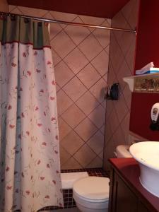 Salle de bains dans l'établissement Hotellerie Jardins de Ville