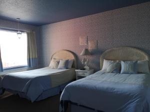 Un ou plusieurs lits dans un hébergement de l'établissement Hotellerie Jardins de Ville