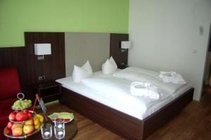 A bed or beds in a room at Landhotel Steiner
