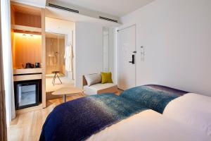 A bed or beds in a room at TSUKI Tokyo