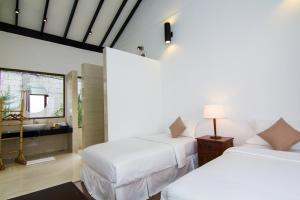 Cama o camas de una habitación en BuBu Villa