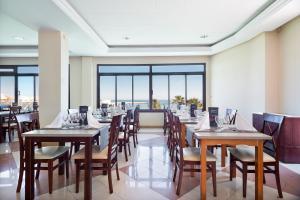 En restaurang eller annat matställe på Hotel Best Triton