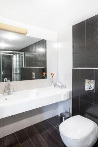 A bathroom at Mabre Residence