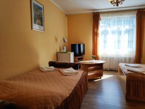 Posteľ alebo postele v izbe v ubytovaní Elīna