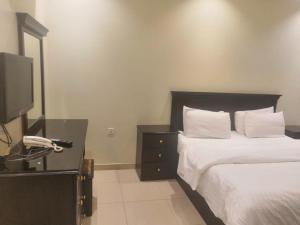 Cama ou camas em um quarto em أبها ريجنسي