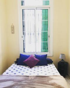 A bed or beds in a room at Green Door Gracia