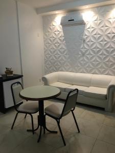 A seating area at Fenix Hotel Pouso Alegre