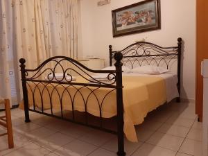 A bed or beds in a room at Pergola Hotel