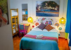 Ein Bett oder Betten in einem Zimmer der Unterkunft Paypurix Hostel Lima Airport