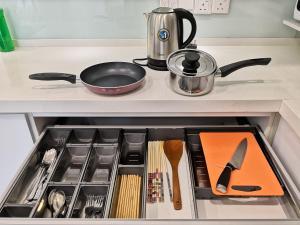 A kitchen or kitchenette at Strait Garden Suite @ Penang Centre