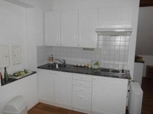 Кухня или мини-кухня в ABC apartments