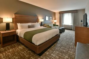 A bed or beds in a room at GrandStay Hotel & Suites