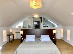 Un ou plusieurs lits dans un hébergement de l'établissement Galerie, Tumulus de la Hogue