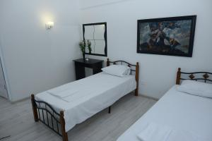 A bed or beds in a room at DeltaFly Hotel