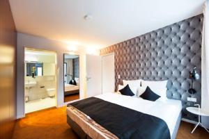 سرير أو أسرّة في غرفة في بانديون بواردينغهاوس