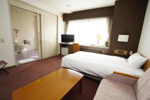 A bed or beds in a room at Fukuoka Toei Hotel