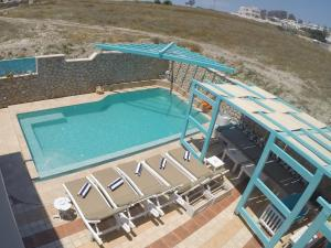 A view of the pool at Villa Rose or nearby